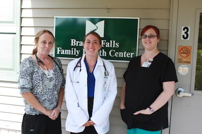 Brasher Falls Family Health Center team standing outside the facility
